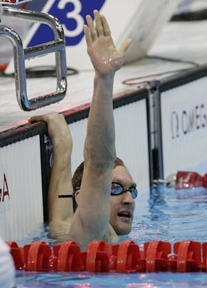 United States' Bradley Snyder waves after winning the men's 400m freestyle S11 final at the 2012 Paralympics, Friday, Sept. 7, 2012, in London. Friday also marks the one-year anniversary of when Snyder stepped on an IED in Afghanistan where he was serving with the US forces and lost his sight. (AP Photo/Lefteris Pitarakis)