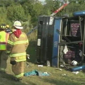 BUS CRASH LEAVES ONE DEAD, DOZENS INJURED