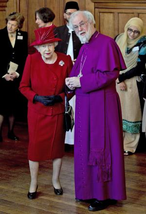 """FILE - Britain's Queen Elizabeth II, front left, talks with the Archbishop of Canterbury Rowan Williams, in London as they attend a multi-faith reception to mark the Diamond Jubilee of the Queen's Accession to the throne when as part of her title she became Defender of the Faith, in this file photo dated Wednesday, Feb. 15, 2012.  In an interview published Saturday Sept. 8, 2012, in Britain's Daily Telegraph newspaper, Williams said the Anglican Church is planning to give some of the global duties of the Archbishop of Canterbury to a """"presidential"""" figure so the archbishop can concentrate on leading the Church of England, and admitted he didn't do enough to prevent divisions in the Anglican church over homosexuality.  (AP Photo/Matt Dunham, File)"""