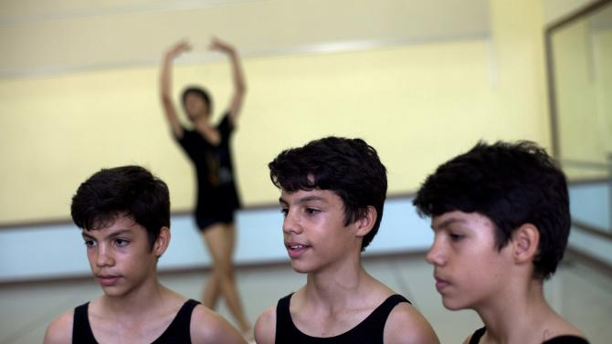 CORRECTING MARCO TO MARCOS -  In this April 3, 2013 photo, identical triplets Marcos, left, Cesar, center, and Angel Ramirez Castellanos stand together before their ballet class at the National School of Ballet in Havana, Cuba. The Ramirezes, born into a family that lives in the gritty neighborhood of Center Havana, say they are extremely close. (AP Photo/Ramon Espinosa)