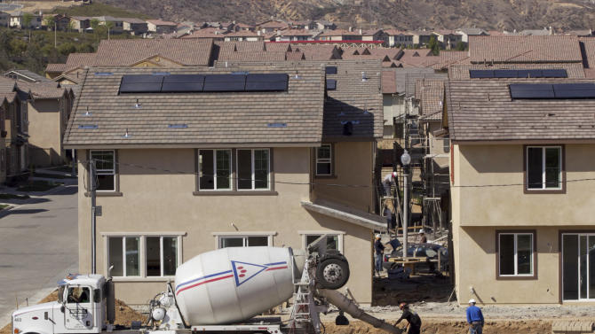 US housing market boosted by jobs, higher rents