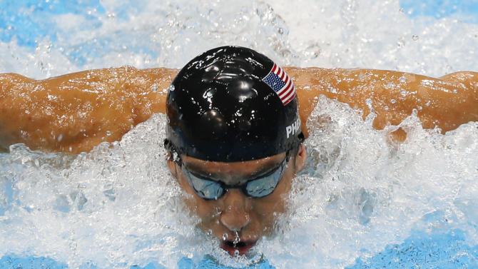 United States' Michael Phelps swims in the men's 4 X 100-meter medley relay at the Aquatics Centre in the Olympic Park during the 2012 Summer Olympics in London, Saturday, Aug. 4, 2012. (AP Photo/Julio Cortez)
