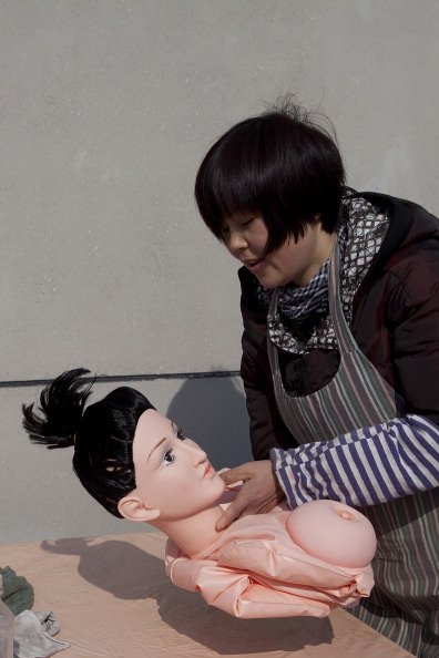 NINGBO, CHINA - FEBRUARY 19: (CHINA OUT) A migrant worker packs finished sex dolls at the Jiamei Plastic Toy Factory, on February 19, 2012 in Ningbo, China. The Jiamei plastic toy company, based in th