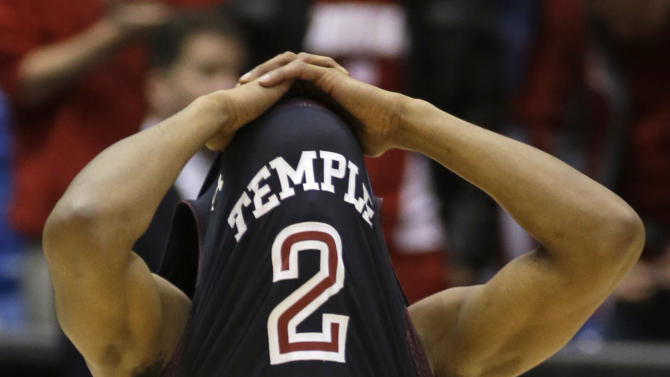 Temple guard Will Cummings covers his face after they lost to Indiana 58-52 in a third-round game of the NCAA college basketball tournament, Sunday, March 24, 2013, in Dayton, Ohio. (AP Photo/Al Behrman)