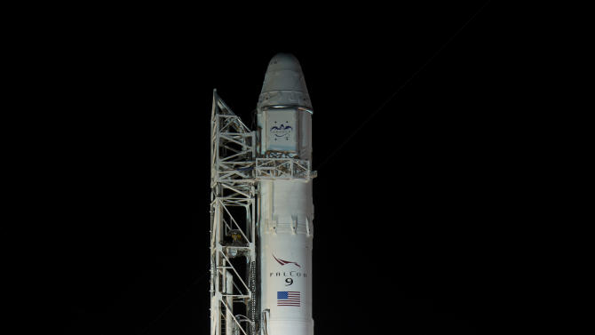 In a photo provided by NASA, the SpaceX Falcon 9 rocket, with it's Dragon spacecraft onboard, is seen shortly after it was erected at Launch Complex 40 at the Cape Canaveral Air Force Station in Florida on Friday, March 1, 2013. Launch of the second SpaceX Commercial Resupply Services mission is scheduled for later Friday morning.  (AP Photo/Nasa, Bill Ingalls)