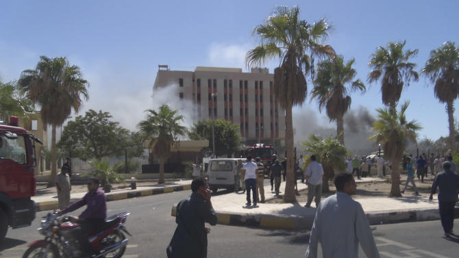 Smoke rises from a security headquarters building in the southern Sinai town of el-Tor, Egypt, after a car bombing there on Monday, Oct. 7, 2013. Monday's attack, which killed several people and wounded dozens, came a day after at least 51 people died in clashes between security forces and supporters of ousted President Mohammed Morsi across much of Egypt. The region of southern Sinai, which includes the popular resort of Sharm el-Sheikh, has been mostly quiet since a series of deadly attacks in 2005 and 2006. (AP Photo)