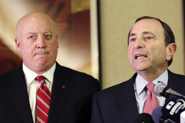 FILE - In this Dec. 6, 2012, file photo, NHL Commissioner Gary Bettman, right, and deputy commissioner Bill Daly speak to reporters in New York. Bettman has told the players union that a deal must be in place by Jan. 11 in order for a 48-game season to be played beginning eight days later.(AP Photo/Mary Altaffer, File)