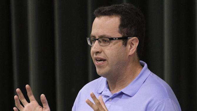 FILE - In this Sept. 18, 2013 file photo, longtime Subway front man Jared Fogle speaks to students about healthy eating and exercise at Battle Academy in downtown Chattanooga, Tenn. FBI agents and Indiana State Police on Tuesday, July 7, 2015 raided Fogle's Zionsville, Ind. home and have removed electronics from the property. (Dan Henry/Chattanooga Times Free Press via AP)