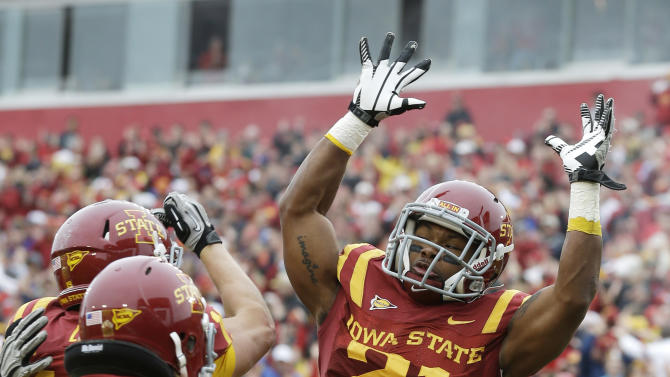 Iowa State running back Shontrelle Johnson (21) celebrates with teammates after scoring a touchdown during the first half of an NCAA college football game against Kansas State, Saturday, Oct. 13, 2012, in Ames, Iowa. (AP Photo/Charlie Neibergall)