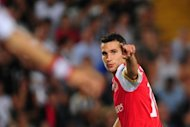 Arsenal forward Robin van Persie celebrates after scoring a goal during a football match in August 2011. Arsenal will guarantee themselves automatic qualification for the group phase if they win at West Bromwich Albion