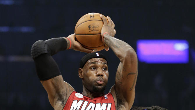 Miami Heat forward LeBron James looks to pass against Brooklyn Nets forward Gerald Wallace during the first half of an NBA basketball game, Wednesday, Jan. 30, 2013, in New York. (AP Photo/Kathy Willens)
