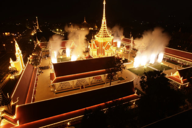 Fireworks explode at the site of cremation for Cambodia's former King Norodom Sihanouk in Phnom Penh, Cambodia, Monday, Feb. 4, 2013. Hundreds of thousands of mourners gathered in Cambodia's capital M
