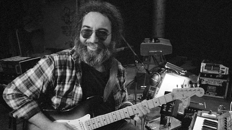"FILE-This May 8, 1979 file photo shows Jerry Garcia, leader of the legendary group ""The Grateful Dead."" Deadheads are uniting in opposition to a proposal to rename a San Francisco venue named in honor of Garcia, Grateful Dead founder. More than 1,100 people have signed an online petition opposing any name change to Jerry Garcia Amphitheater in Excelsior, near where the late guitarist grew up. (AP Photo)"