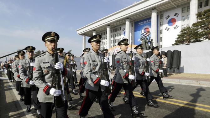 South Korean honor guard soldiers march during a rehearsal of the 18th presidential inauguration ceremony  inside the National Assembly in Seoul, South Korea, Sunday, Feb. 24, 2013. South Korean President-elect Park Geun-hye's inauguration will be held on Feb. 25. (AP Photo/Lee Jin-man)