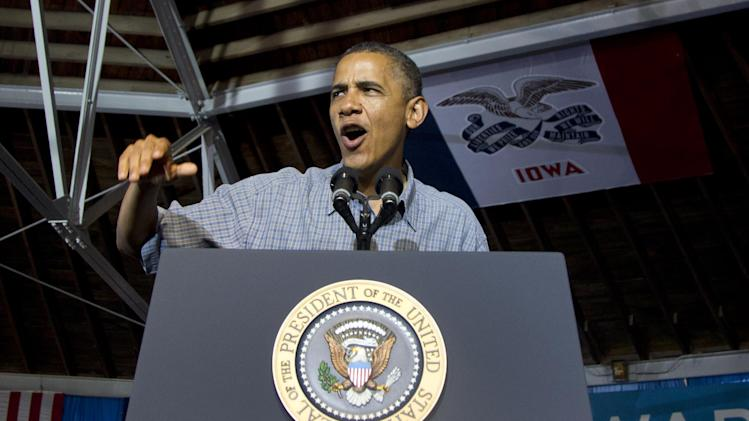President Barack Obama speaks during a campaign event at Herman Park, Monday, Aug. 13, 2012, in Boone, Iowa, during a three day campaign bus tour through Iowa. (AP Photo/Carolyn Kaster)
