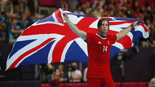 Britain's Steven Larsson acknowleges the crowd with a British flag (Reuters)