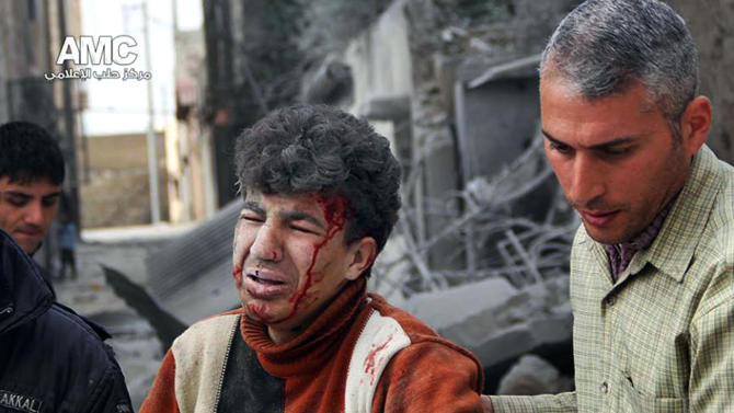 This Tuesday, March. 18, 2014 photo provided by the anti-government activist group Aleppo Media Center (AMC), which has been authenticated based on its contents and other AP reporting, shows a Syrian man helping a wounded man from the scene after a government airstrike in Aleppo, Syria. Activists said Syrian warplanes and helicopter gunships carried out several air raids in the northern province of Aleppo on Tuesday killing and wounding a number of people. (AP Photo/Aleppo Media Center AMC)