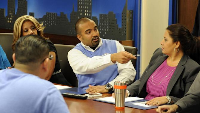 "This undated publicity image released by Fox shows employees of Velocity Merchant Services (VMS) in Downers Grove, Ill., in a scene from the reality workplace series, ""Does Someone Have to Go?"" The network will begin airing a nonfiction show where employees of small businesses are compelled to rat out underperforming colleagues and put their jobs at risk. The series premieres Thursday, May 23 at 8 p.m. EST on Fox. (AP Photo/Fox"