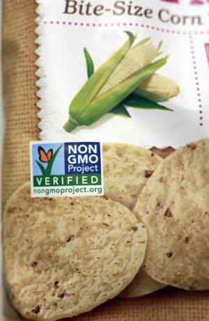 "A product labeled with Non Genetically Modified Organism (GMO) is sold at the Lassens Natural Foods & Vitamins store in Los Feliz district of Los Angeles Friday, Oct. 5, 2012. International food and chemical conglomerates are spending millions to defeat California's Proposition 37, which would require labeling on all food made with altered genetic material. It also would prohibit labeling or advertising such food as ""natural."" (AP Photo/Damian Dovarganes)"