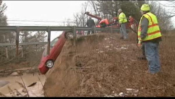 Heavy rains wash away part of a Michigan road