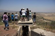 Israelis look from an army post near Buqaata in the Golan Heights towards the Syrian village of Jebata al-Khashab. Israeli Prime Minister Benjamin Netanyahu offered to quit the occupied Golan Heights in exchange for peace with Syria in US-mediated negotiations last year, Yediot Aharonot daily said on Friday