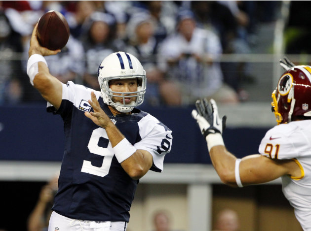 Dallas Cowboys quarterback Tony Romo (9) passes under pressure from Washington Redskins outside linebacker Ryan Kerrigan (91) in the first half of an NFL football game, Thursday, Nov. 22, 2012 in Arli