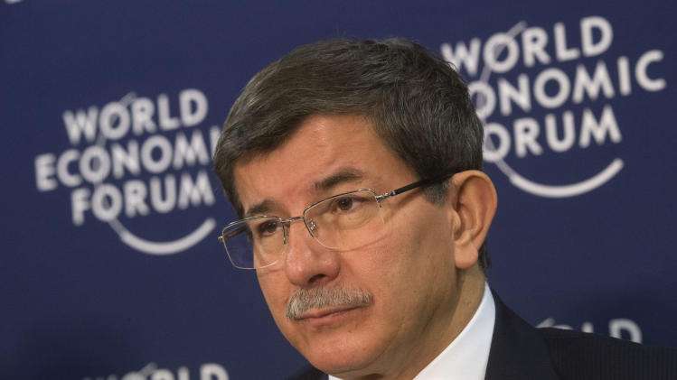 Turkish Foreign Minister Ahmet Davutoglu, is seen during a press conference on Syria at the 43rd Annual Meeting of the World Economic Forum, WEF, in Davos, Switzerland, Wednesday, Jan. 23, 2013. (AP Photo/Michel Euler)