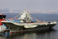 China's first aircraft carrier, a former Soviet carrier called the Varyag, docked on September 24, 2012 after its handover to the People's Liberation Army navy in Dalian, northeast China's Liaoning province