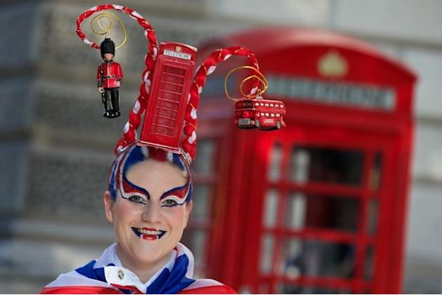 A member of the street theater company Osadia from Barcelona showcases British-themed 'hair art' on August 9 in London