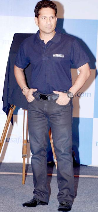 Sachin Tendulkar poses at a product launch