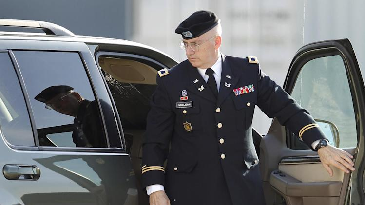 Lead prosecutor, U.S. Army Col. Michael Mulligan, arrives at the Lawrence H. Williams Judicial Center as proceedings in the court martial of U.S. Army Maj. Nidal Malik Hasan continue, Thursday, Aug. 22, 2013, in Fort Hood, Texas. (AP Photo/Tony Gutierrez)