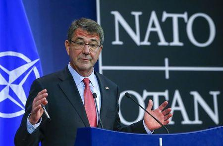 U.S. Secretary of Defense Ash Carter gestures during a news conference during a NATO Defence Ministers meeting at the Alliance's headquarters in Brussels