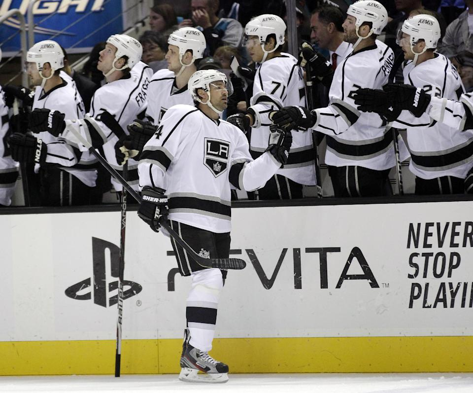Los Angeles Kings right wing Justin Williams (14) celebrates his goal with teammate during the first period of an NHL hockey game against the San Jose Sharks on Saturday, April 7, 2012 in San Jose, Calif. (AP Photo/Marcio Jose Sanchez)