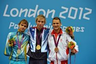 Ukraine's silver medallist Yevheniy Bohodayko (left) poses with other winners during the victory ceremony for the men's 100m backstroke at the London 2012 Paralympic Games in August. Ukraine's stunning success at the Paralympic Games came despite rather than because of attitudes at home, where people with disabilities face huge struggles, the head of its Paralympic Committee told AFP