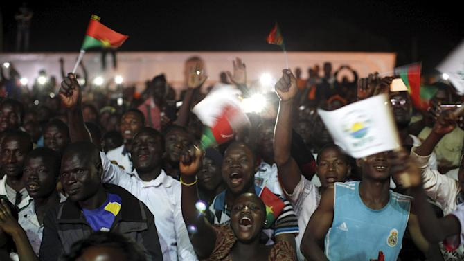 Supporters of President-elect Roch Marc Kabore cheer at Kabore's campaign headquarters in Ouagadougou