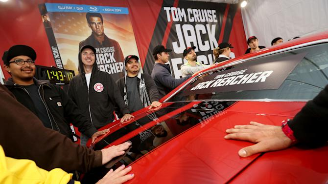 IMAGE DISTRIBUTED FOR PARAMOUNT HOME MEDIA DISTRIBUTION - Contestants begin their long battle as the competition to win a classic 1971 Chevelle SS, like the one featured in the action-packed film JACK REACHER, kicks off at the Hollywood & Highland Center on Monday, May 6, 2013 in Hollywood, Calif.  The competition celebrates the arrival of the movie on Blu-ray, DVD and Digital Download on May 7th. (Photo by Casey Rodgers/Invision for Paramount Home Media Distribution/AP Images)