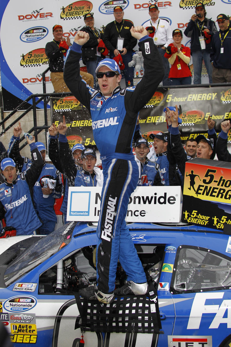 Driver Carl Edwards celebrates in victory lane after winning the NASCAR Nationwide series 5-hour ENERGY 200 auto race, Saturday, May 14, 2011, in Dover, Del. (AP Photo/Russ Hamilton Sr.)