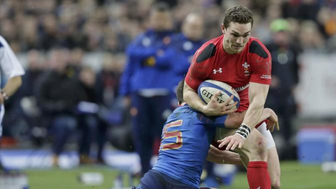 Wales' North attempts to evade the tackle of France's Dulin during their Six Nations rugby union match at the Stade de France stadium in Saint-Denis, near Paris