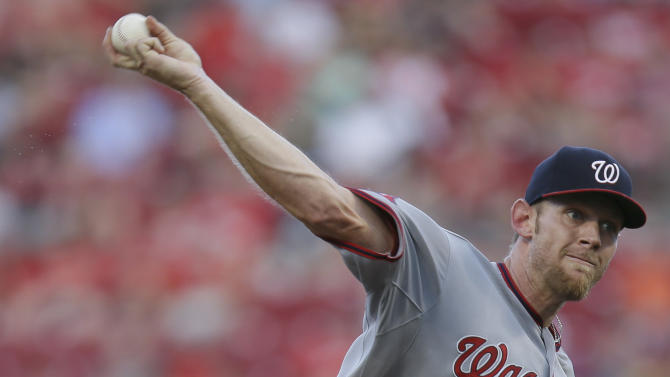 Washington Nationals starting pitcher Stephen Strasburg throws in the first inning of a baseball game against the Cincinnati Reds, Friday, May 29, 2015, in Cincinnati. (AP Photo/John Minchillo)