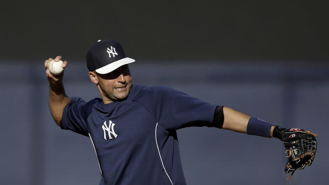 New York Yankees' Derek Jeter throws during a workout before a spring training baseball game against the Atlanta Braves, Tuesday, March 5, 2013, in Tampa, Fla. (AP Photo/Matt Slocum)