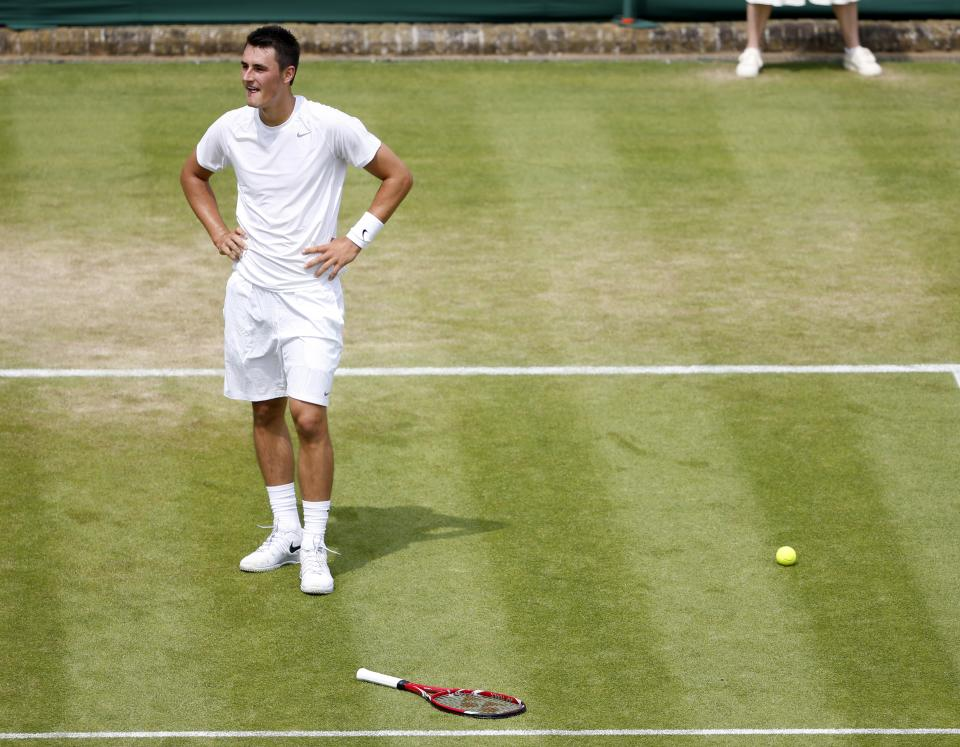 Bernard Tomic of Australia reacts as James Blake of the United States contests a line call during their Men's second round singles match at the All England Lawn Tennis Championships in Wimbledon, London, Thursday, June 27, 2013. (AP Photo/Sang Tan)