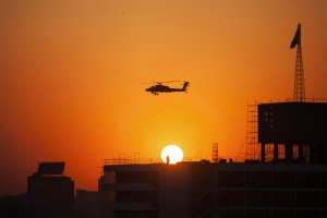 An Egyptian Army helicopter flies over thousands of…