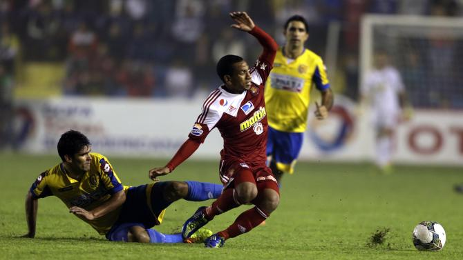 Otero of Venezuela's Caracasis challenged by Gonzalez of Paraguay's Deportivo Capiata during their Copa Sudamericana soccer match in Capiata