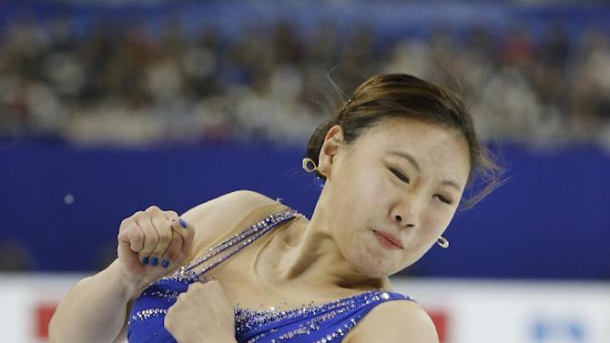 Kim Hae Jin of South Korea performs during the Ladies Free Skating event in the ISU World Figure Skating Championship 2015 held at the Oriental Sports Center in Shanghai, China, Saturday, March 28, 2015. (AP Photo/Ng Han Guan)
