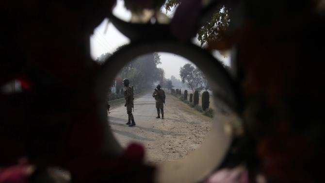 Paramilitary soldiers patrol near the school which was attacked by Taliban gunmen, in Peshawar