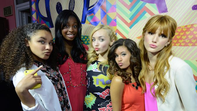 """IMAGE DISTRIBUTED FOR SABAN BRANDS - From left, Jaylen Barron, Coco Jones, Peyton List, guest and Bella Thorne pose at the photo booth during the Paul Frank """"Let's Have a Fun Day"""" event, on Monday, April, 8th, 2013 in Los Angeles. (Photo by Jordan Strauss/Invision for Saban Brands/AP Images)"""