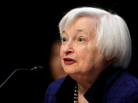 Asian shares down, dollar firms on Yellen's rate hike signal