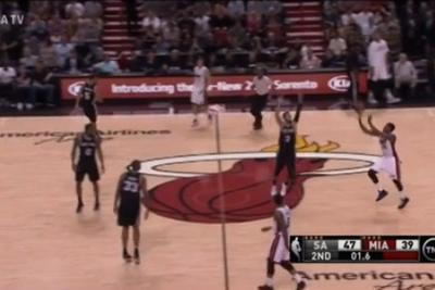 Mario Chalmers casually swishes a 55-foot buzzer-beater