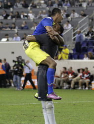 Ecuador goalkeeper Maximum Banguera, right, and defender Eduardo Morante celebrate after the final whistle in a 1-0 victory over the United States in an international soccer friendly game, Tuesday, Oct. 11, 2011, in Harrison, N.J. Ecuador won 1-0. (AP Photo/Julio Cortez)