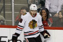 Chicago Blackhawks right wing Patrick Kane celebrates after scoring on Minnesota Wild goalie Devan Dubnyk during the first period of Game 3 in the second round of the NHL Stanley Cup hockey playoffs in St. Paul, Minn., Tuesday, May 5, 2015. The Blackhawks won 1-0. (AP Photo/Ann Heisenfelt)